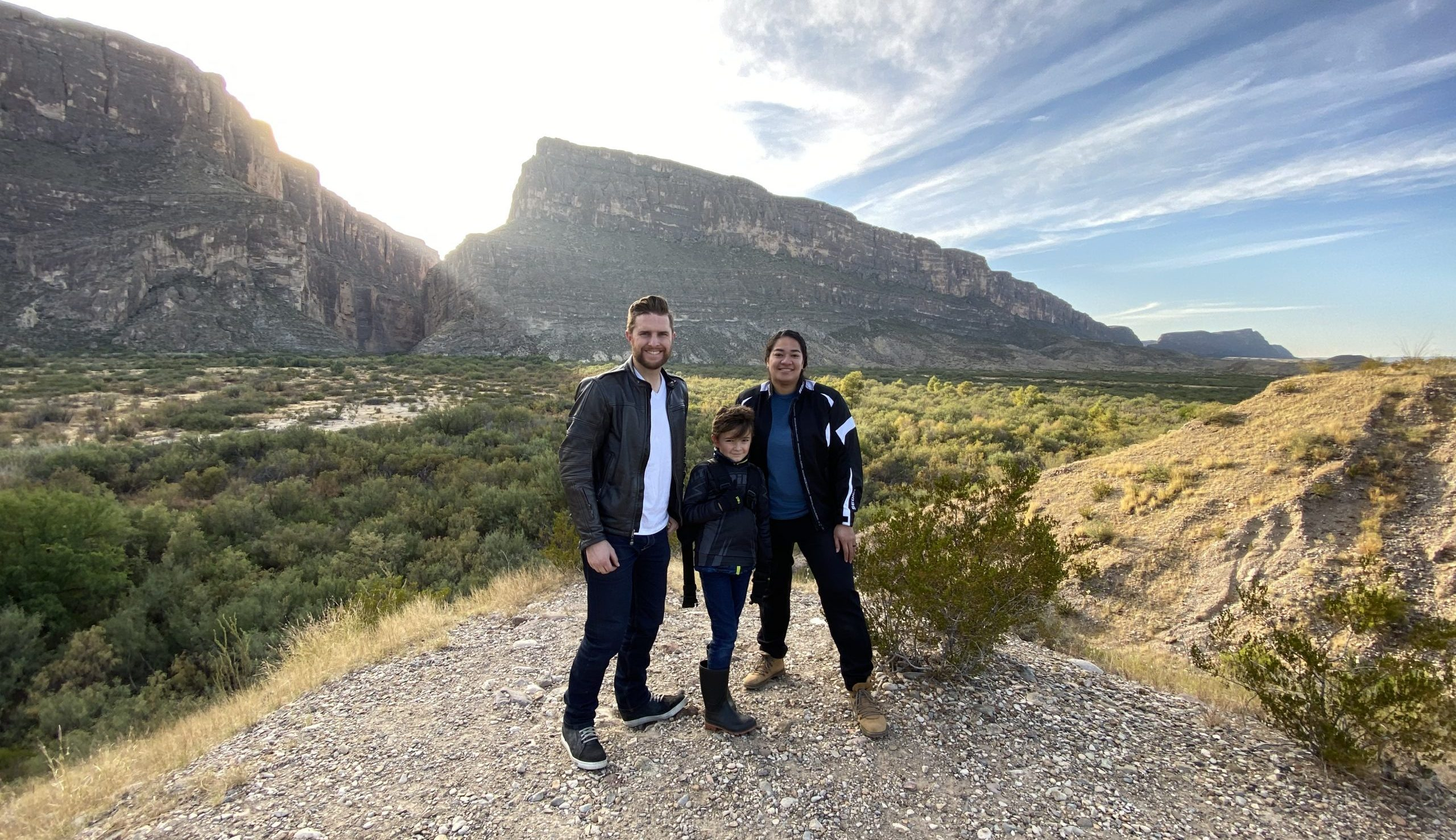 Northrup family standing in front of canyon and sunset in Big Bend Texas