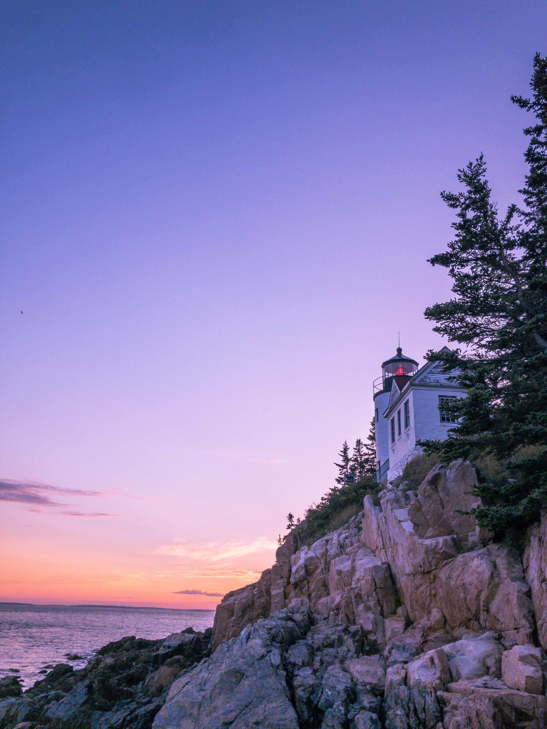 Sunset with lighthouse at Acadia National Park